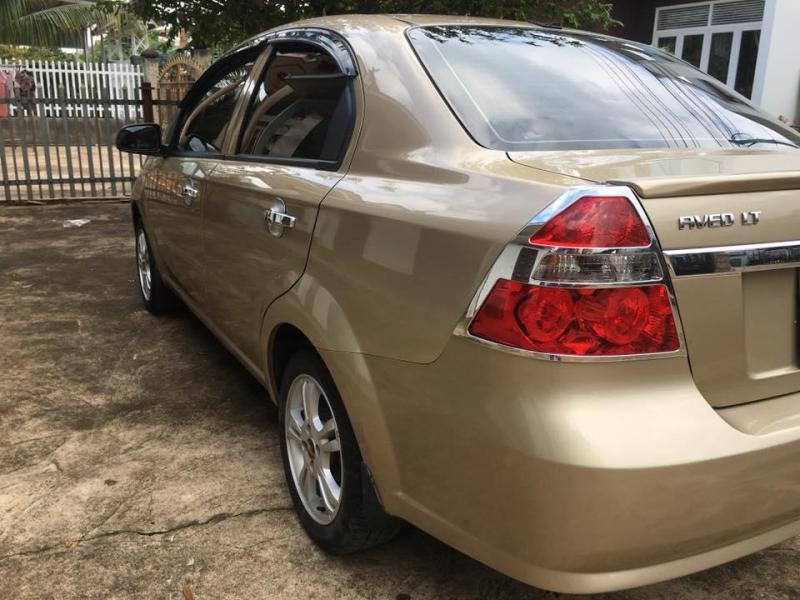 Bán Chevrolet Aveo LT 2015 vàng cát số sàn đẹp zin nguyên