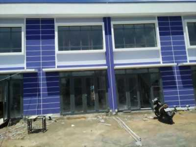 Bán nhà phố mặt tiền QL13, gần KDL Đại Nam