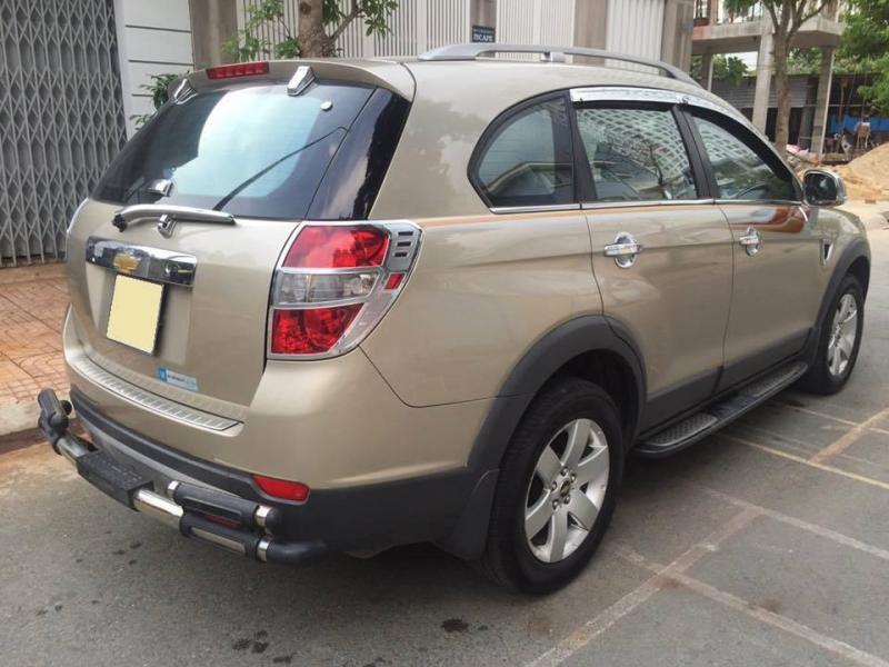 Gia đình cần bán xe Captiva 2009 bản LT, số sàn, màu vàng cát.