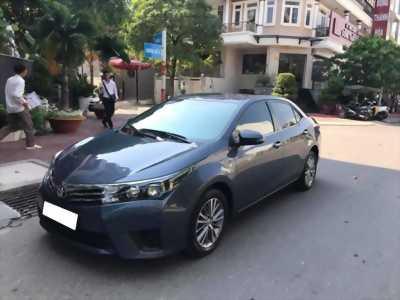 Cần tiền bán xe ô tô Altis 2015, sô sàn, màu xanh