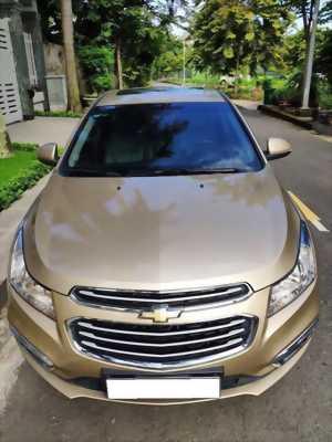 Cần bán em xe Chevrolet Cruze  2017 tự động, màu vàng cát.