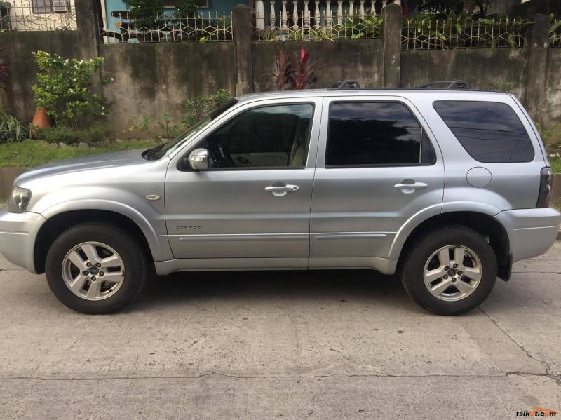 Cần bán xe Escape 2006, số tự động, màu bạc, zin cọp. odo 112.000km.