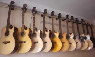 Bán đàn guitar làm từ gỗ hồng đào ,còng cườm ,điệp giá rẻ tại Hóc Môn