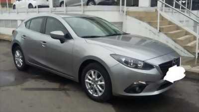 Cần bán gấp Mazda 3 2015 hatchback . Xe màu xám chì