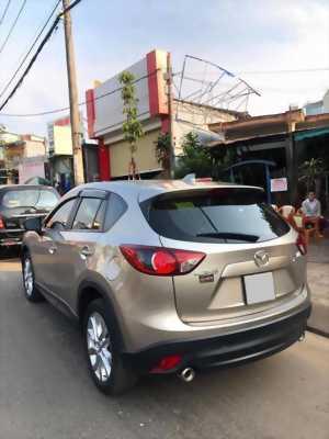Cần bán xe Mazda Cx5 đời 2015 bản 2.5L full option màu bạc rất keng, xe gia đình trùm mền ít sử dụng