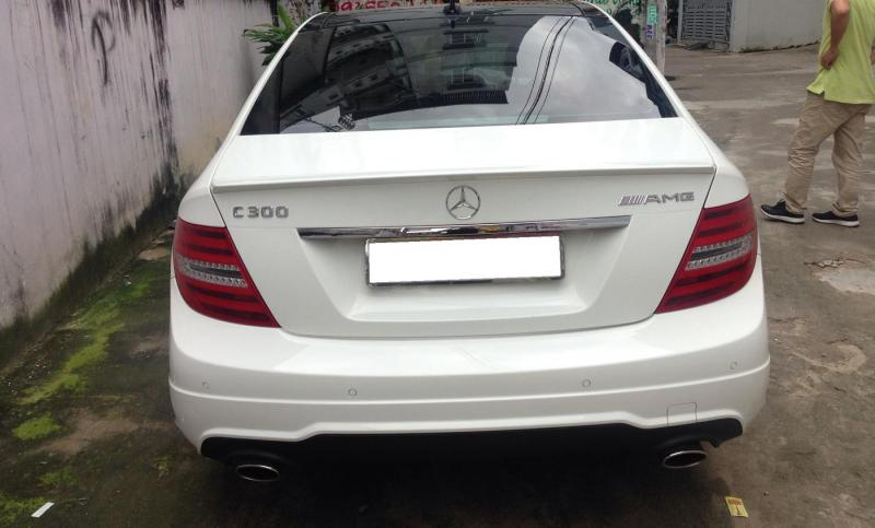 Bán xe Mercedes C300 AMG 2014 màu trắng tại HCM