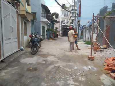 Nhà 2MT, 1 Lầu, hẻm thông 6m Bùi Đình Túy.