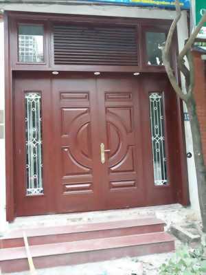 Cửa cổng chính chất liệu thép vân gỗ cao cấp 18.4
