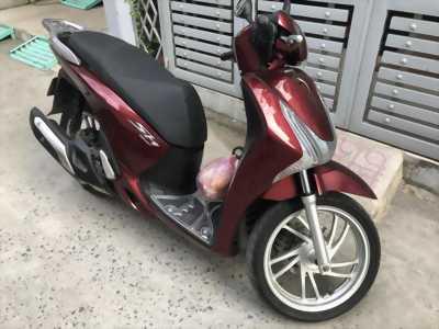 Em cần bán xe máy Honda SH125i 2015 màu đỏ mận