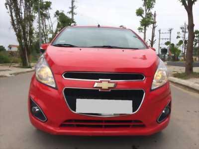 Gia đình bán Chevrolet Spark LTZ 2014 màu đỏ rất mới.