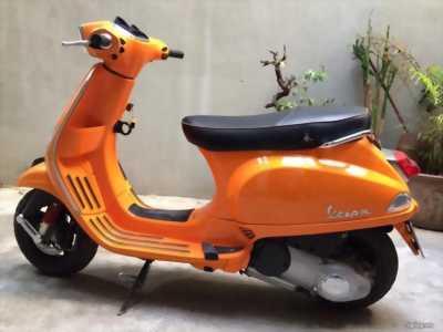 Vespa Lx 125ie Việt màu cam đăng kí 2012 chính chủ quận 1