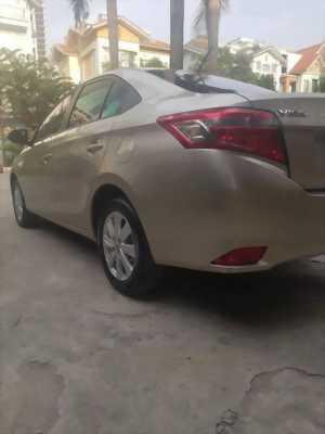 Gia đình cần bán Toyota Vios sx 2016 số tự động màu vàng cát